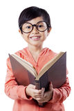 Sweet elementary school student reads books Stock Images