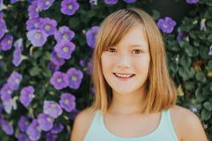 Outdoor fashion portrait of cute preteen girl. Sweet and emotional preteen girl, outdoor summer portrait Stock Photos