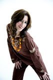 Sweet ethnic dress active girl. Happy smiling woman in a ethnic brown top and pants with a very active pose Royalty Free Stock Photography