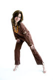 Sweet ethnic dress active girl. Happy smiling woman in a ethnic brown top and pants with a very active pose full body Royalty Free Stock Photo