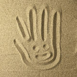 Sweet face in the sand handwriting in the sand. Golden colors Royalty Free Stock Photography