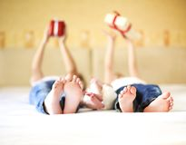Sweet family in bed. Three sisters, close up on feet. Holiday and happiness concept royalty free stock photo