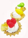 Sweet fancy cakes with fruits Royalty Free Stock Photos