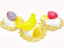 Sweet fancy cakes with fruits Stock Image