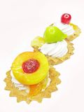 Sweet fancy cakes with fruits Royalty Free Stock Photography