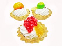 Sweet fancycakes with fruits Stock Photos