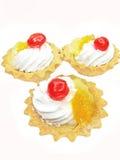 Sweet fancycakes with fruits Stock Image