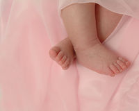Sweet Feet. Baby feet on pink background Stock Photography