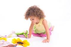 Sweet female child on the floor Stock Photos