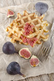 Sweet fig and home baked waffle. With a fork on brown paper Royalty Free Stock Photography