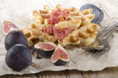 Sweet fig and home baked waffle. With a fork on brown paper Stock Images