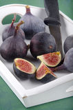 Sweet fig and knife on serving tray Royalty Free Stock Image