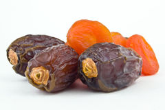 sweet figs and dried apricots on white background Royalty Free Stock Photography