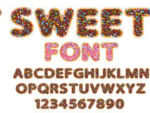 Sweet font alphabet and numeral. Sweet flat  rounded font alphabet and numeral signs with bakery sprinkles topping stars, dots and lines Royalty Free Stock Photo
