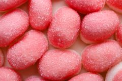 Pink jellies or marshmallows as background royalty free stock photography