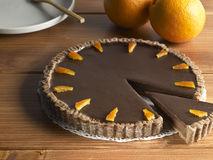 Sweet food dessert, chocolate cake and orange. On a wood background Royalty Free Stock Photos