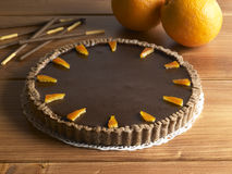 Sweet food dessert, chocolate cake and orange. On a wood background Royalty Free Stock Images