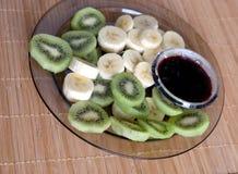 Sweet food. Kiwi, bananas slice and jam closeup Royalty Free Stock Photography