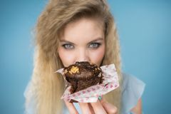 Attractive woman holds cake in hand stock photography