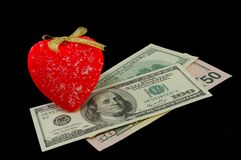Sweet in the form of heart and dollars Royalty Free Stock Image