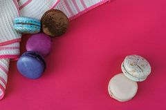 Sweet french macarons. Colorful bisquits. Top view. Copy text space. Table cloth Stock Photos