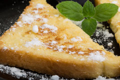 Sweet french toast. With sugar and mint Stock Photos