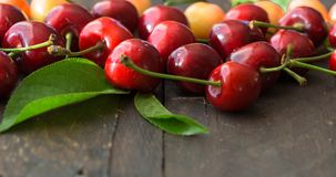 Free Sweet Fresh Cherries Background. Scattered Cherries On Blue Rustic Wood Pattern With Copy Space. Cherry Fruit Backround. Garden Fr Stock Photography - 121513862