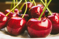 Sweet fresh cherries in film style royalty free stock photos