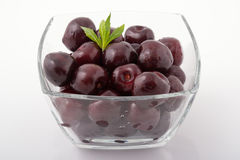 Sweet fresh cherries in a glass bowl Royalty Free Stock Photos