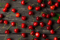 Sweet fresh cherries with water drops on wood Stock Photos