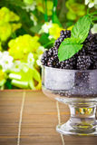 Sweet fresh fruits in glass goblet Stock Photos
