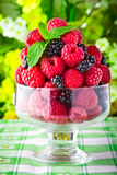 Sweet fresh fruits in glass goblet Stock Image