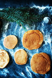 Sweet fresh golden Pancake with honey on a wooden board on a kitchen table with a tablecloth covering of blue. Preparation for tea Stock Image