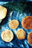 Sweet fresh golden Pancake with honey on a wooden board on a kitchen table with a tablecloth covering of blue. Preparation for tea Royalty Free Stock Photos