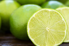 Sweet fresh lemon in natural light on old wood Royalty Free Stock Images
