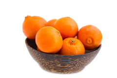 Sweet fresh mandarin in the wood bowl Stock Photos