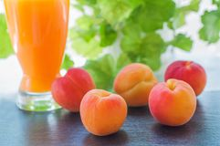 Sweet fresh peaches and juice Royalty Free Stock Images