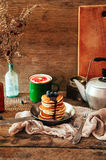 Sweet fresh poppy seed pancakes with chocolate fondant and decorated with fresh raspberries on a wooden board on a kitchen table w. Ith a tablecloth covering of Royalty Free Stock Photos