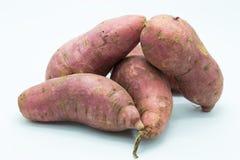 Sweet fresh purple potato on white Stock Images
