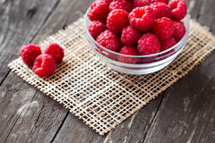 Sweet fresh raspberry in bowl on wood Stock Photos