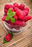Sweet fresh raspberry fruits. In glass goblet Stock Image