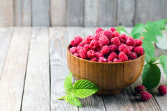 Sweet fresh raspberry and mint on the wooden table Royalty Free Stock Photos