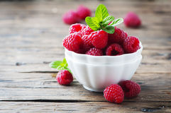 Sweet fresh raspberry and mint on the wooden table. Selective focus Stock Image