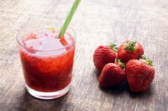 Sweet fresh strawberry juice, smoothies on the wooden table, selective focus Royalty Free Stock Images