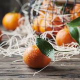 Sweet fresh tangerins on the vintage table Stock Photo