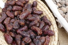 Fresh tasty dates sold at a market. Sweet fresh tasty dates sold at a market Stock Photo