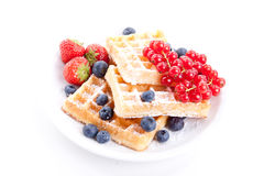 Sweet fresh tasty waffles with mixed fruits  Royalty Free Stock Images