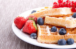 Sweet fresh tasty waffles with mixed fruits  Royalty Free Stock Photos