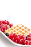 Sweet fresh tasty waffles with mixed fruits isolated Royalty Free Stock Image