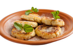 Sweet fried cheese pancake with powdered sugar Royalty Free Stock Images